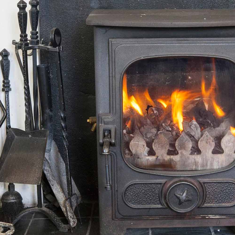 A cosy log fire makes the sitting room a home from home and the views are to die fo